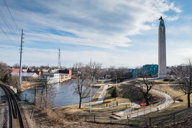 Downtown Plattsburgh and the Saranac River. Plattsburgh, NY / USA / March 23, 2016: Walking trails by Saranac River and Lake Champlain pass the MacDonough royalty free stock images
