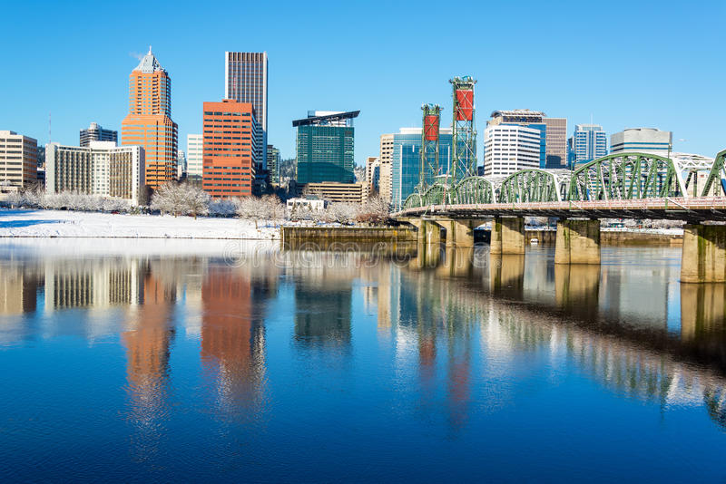 Downtown Portland Reflection. Downtown Portland, Oregon beautifully reflected in the Willamette River with the Hawthorne Bridge royalty free stock photo