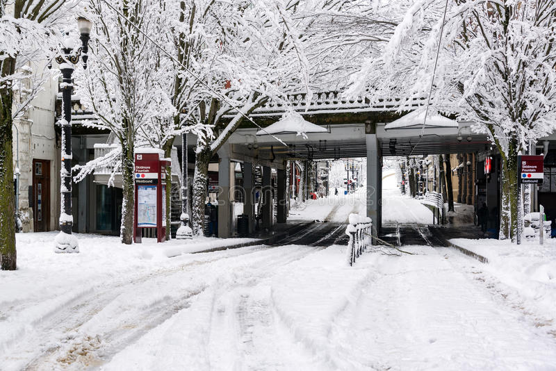 Downtown Portland Street in Snow. Max station under Burnside Bridge in Portland, Oregon after a snowstorm royalty free stock images