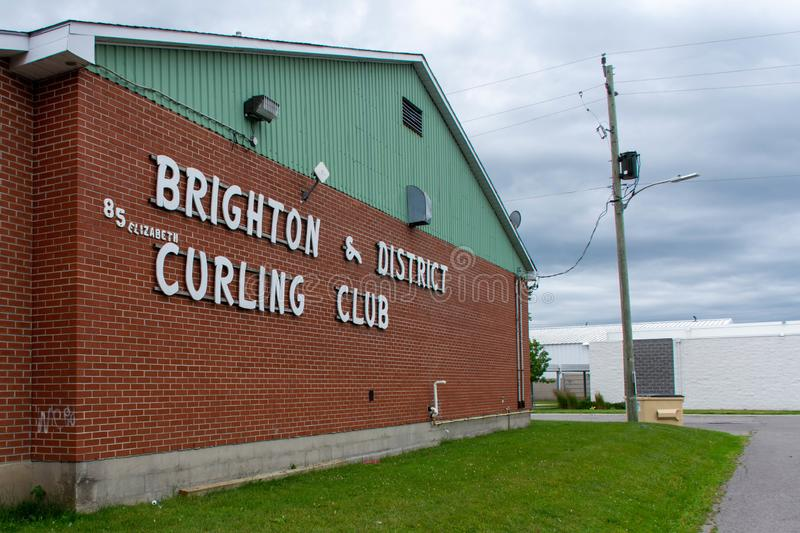Downtown rural sreet of small town Canadian city of Brighton near presquile lake provincial park curling club sign and arena stock photo