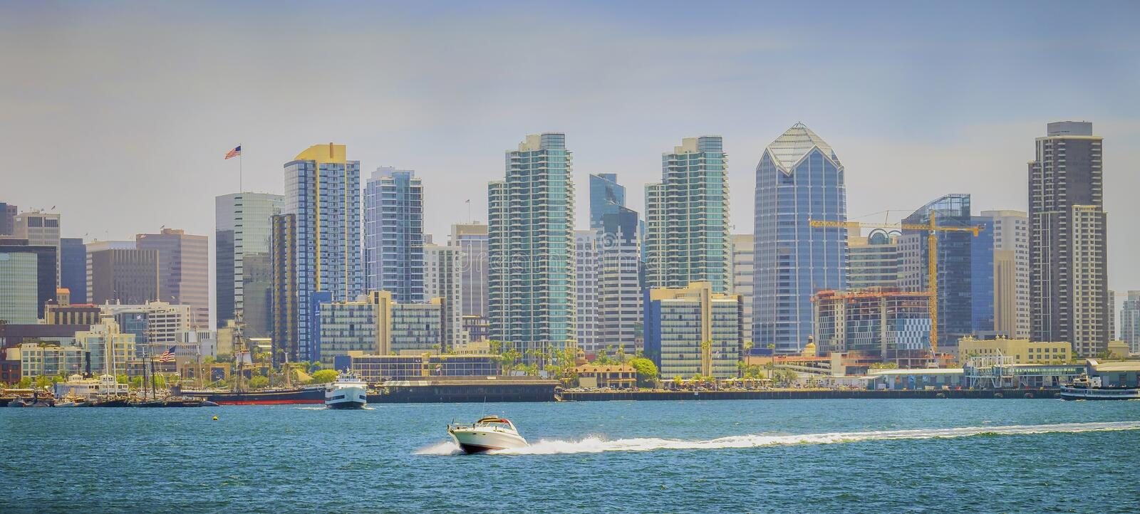 Downtown San Diego Skyline, Panoramic Vista. The downtown skyline of San Diego on the bay, as seen from Harbor Island, with a pleasure boat in the foreground, on stock photography