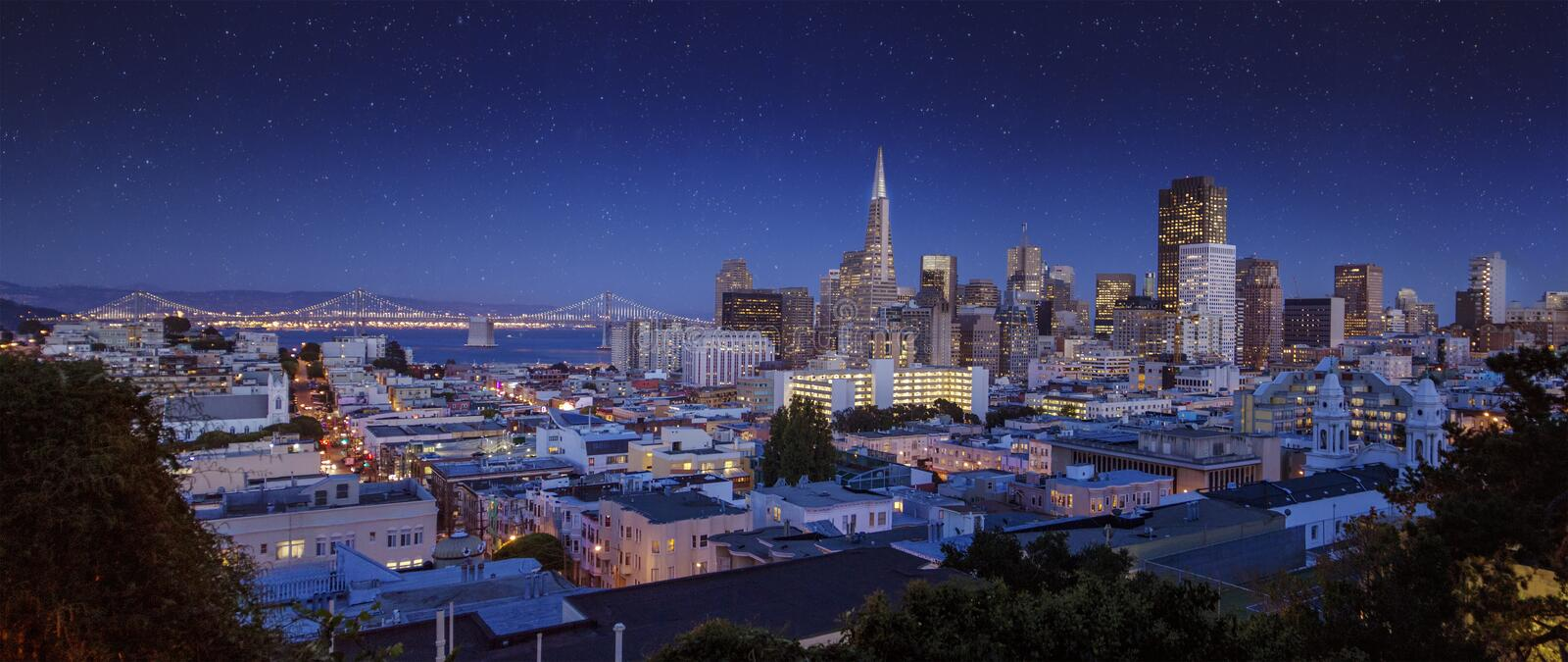 Downtown San Francisco cityscape during early night. Downtown San Francisco cityscape with Bay Bridge in a bright night/late sunset stock photos