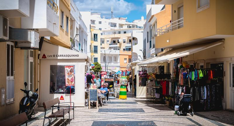 Downtown shopping street atmosphere of Quarteira, Portugal stock images
