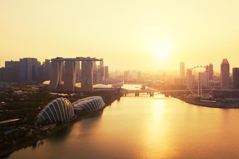 Downtown Singapore city in Marina Bay area. Financial district. And skyscraper buildings. Aerial view at sunset royalty free stock photo