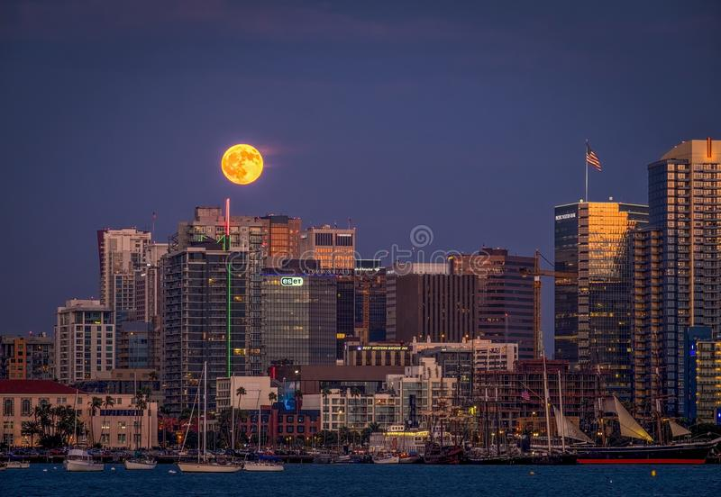 Full Moon, San Diego Skyline, California. The downtown skyline of San Diego, as seen from the bay, at sunset with a full moon above the buildings stock images