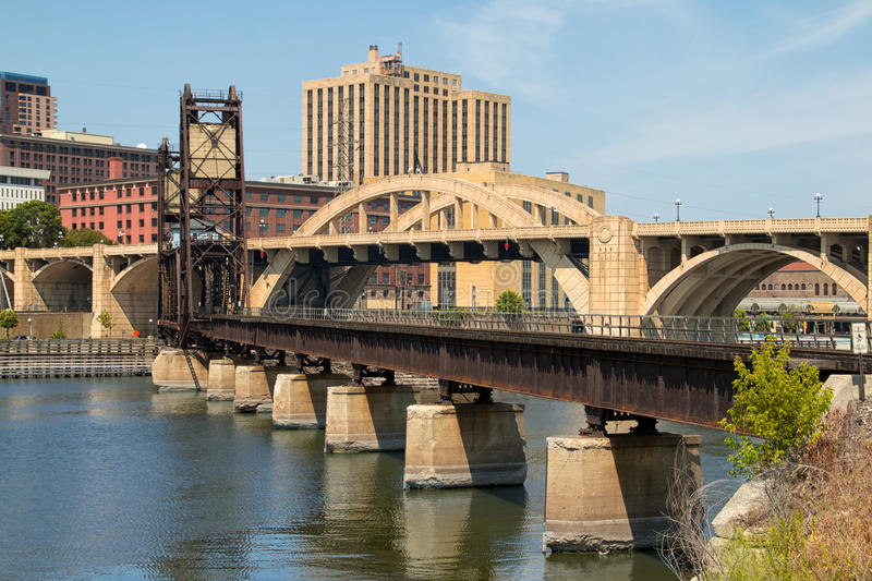 Downtown City of St. Paul, Minnesota, and Bridges. A railroad bridge and street bridge cross the Mississippi river to Harriet Island south of downtown Saint Paul stock photo