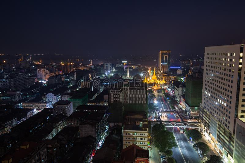 View of downtown Yangon from above at night. Downtown, Sule Pagoda Road and lit Sule Pagoda in Yangon, Myanmar, viewed from above in the evening royalty free stock photography