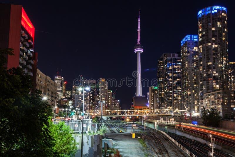 Downtown Toronto and CN Tower at night, Toronto, Canada. Downtown Toronto, CN Tower and railway at night, Toronto, Canada royalty free stock image