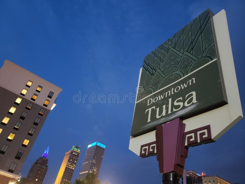 Downtown Tulsa sign and modern buildings, Oklahoma state USA. Downtown Tulsa sign and modern buildings at night, Oklahoma state USA royalty free stock image