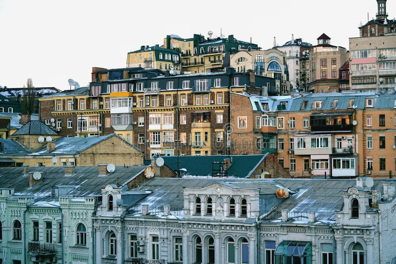 Metropolis center with urban housing and old patrician houses in winter in the daytime, Ukraine, Kiev, Bessarabskaya Square stock images
