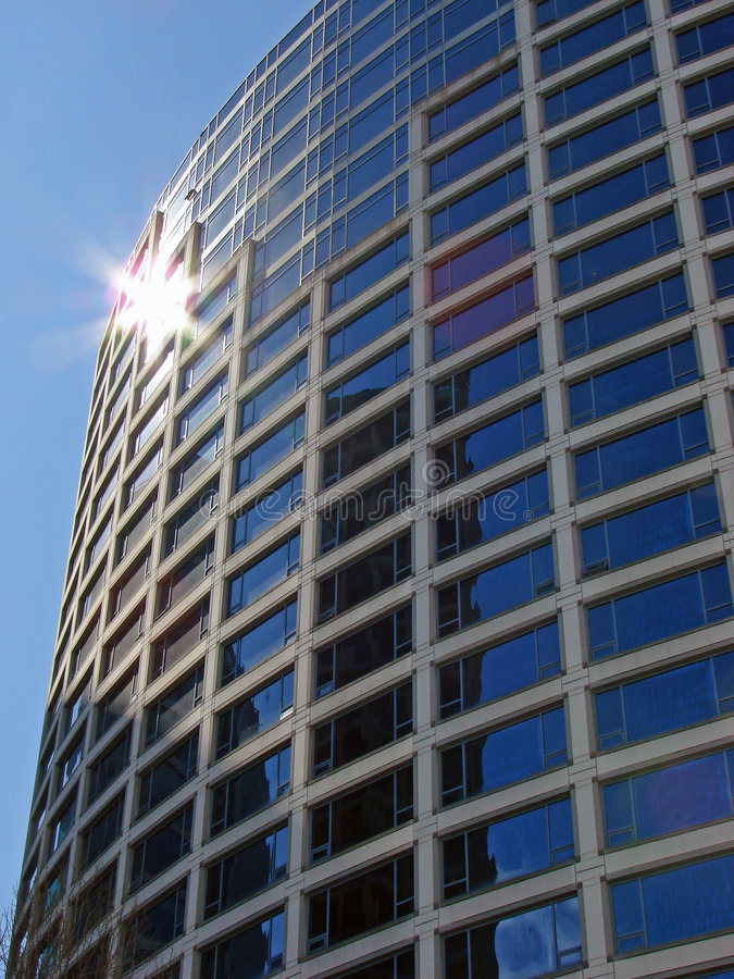 Downtown Vancouver, BC, Canada. The sun reflects in a tall glass building in downtown Vancouver, BC, Canada stock image