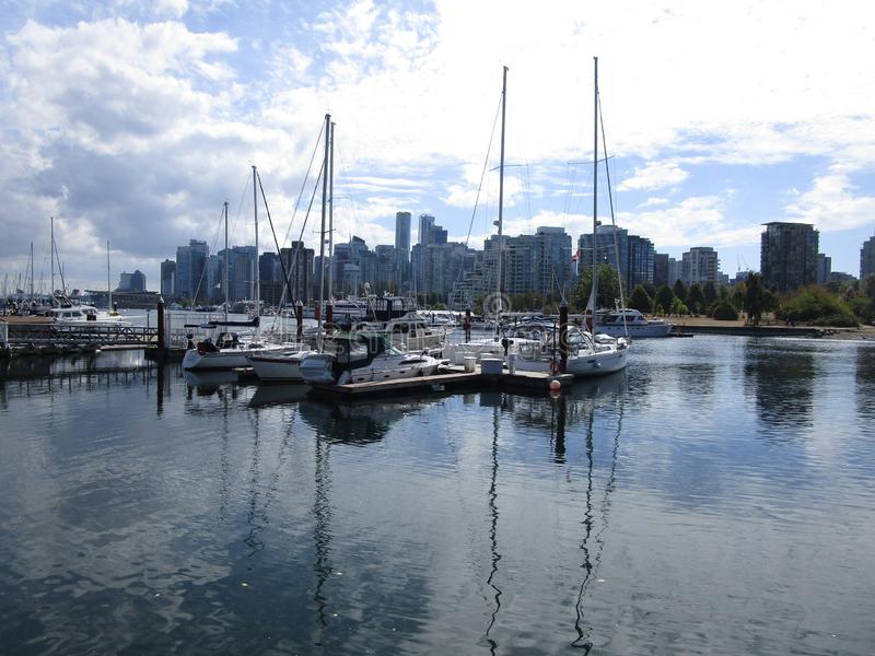 Vancouver skyline and boats at Stanley Park, British Columbia, Canada, 2018. Downtown Vancouver skyline and boats at Stanley Park, British Columbia, Canada stock photo