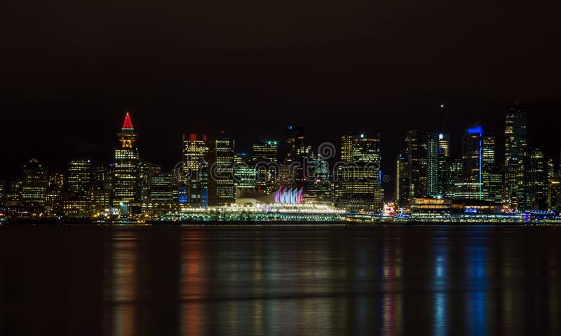 The downtown Vancouver skyline at night. From North Vancouver. Canada Place and Tower Illuminated with Christmas stile stock photos
