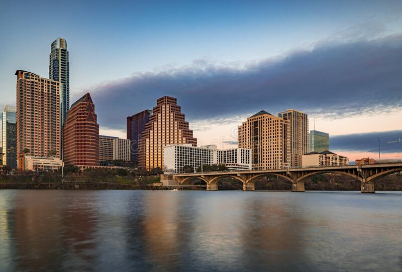 Downtown view across Lady Bird Lake or Town Lake on Colorado River at sunset golden hour in Austin, Texas, USA. Downtown high-rises reflecting sunset golden hour stock images
