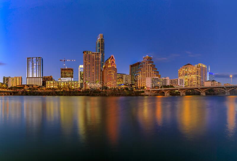 Downtown view across Lady Bird Lake or Town Lake on Colorado River at sunset golden hour in Austin, Texas, USA. Downtown high-rises reflecting sunset golden hour stock photography