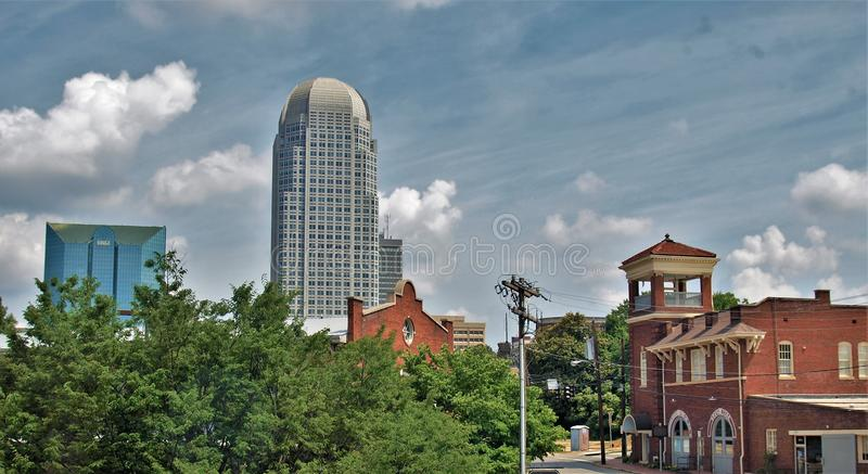 Downtown Winston-Salem, North Carolina. Puffy white clouds hang overhead the skyline of Winston-Salem, North Carolina royalty free stock image