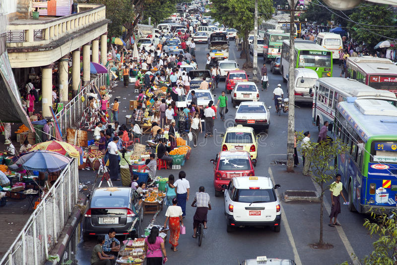 Downtown Yangon. A view of downtown Yangon, with bustling market activities in the street stock image