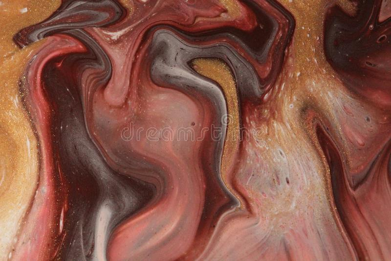 Pink, white, chocolate brown, and glittering gold flow vertically in this abstract background. Downward movement in pink, chocolate brown, white, and glittering stock photography