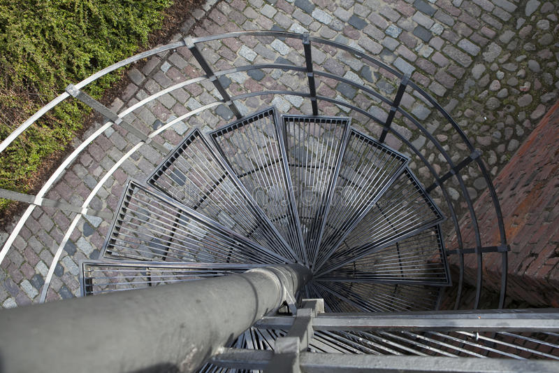 Downward Spiral, Spiral staircase in old town in Warsaw, Poland stock photos