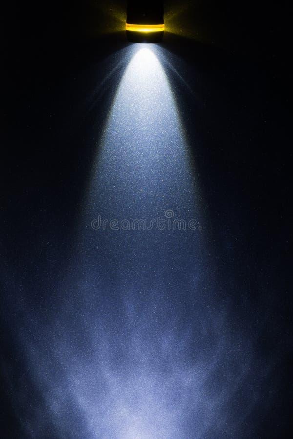 DOWODZONA latarka na metal powierzchni obraz royalty free