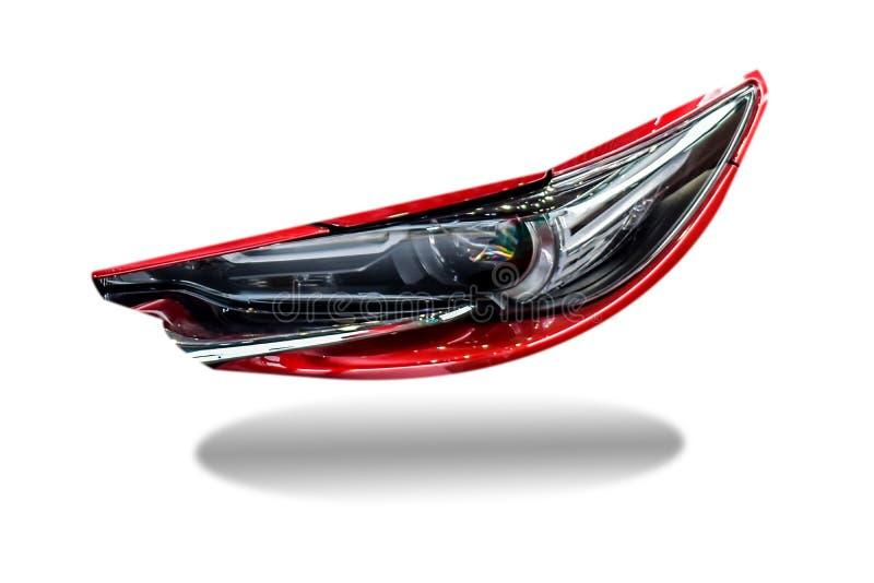 Dowodzony reflektoru samochód na odosobnionym dla klientów Używać tapetę lub obraz stock