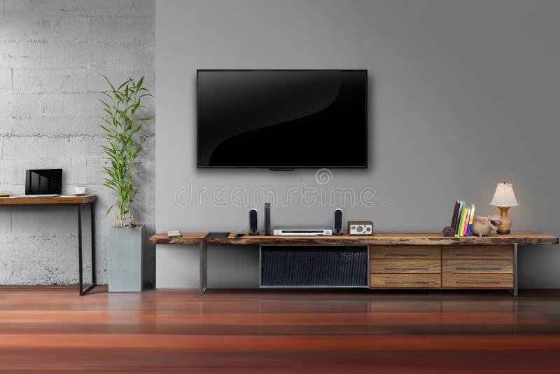 Dowodzony tv na szarości ściany kolorze z drewnianym stołowym medialnym meble zdjęcia stock