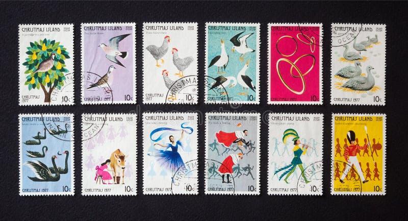 Doze dias do Natal em selos postais imagens de stock