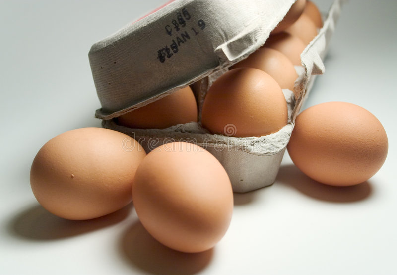 Dozen Brown Eggs. In carton stock photos