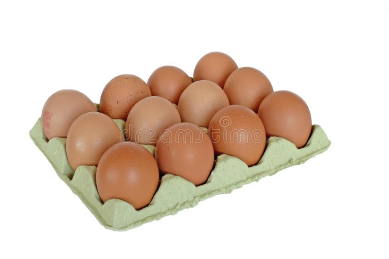 Dozen eggs. In the box in isolated over white royalty free stock images