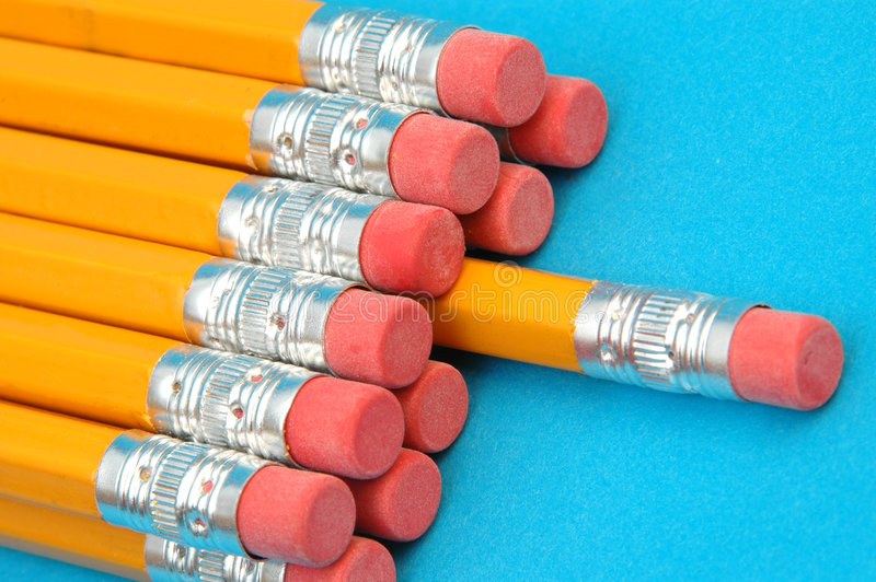 Dozen new pencils. There's one in every crowd, a dozen new pencils with focus on the erasers stock images