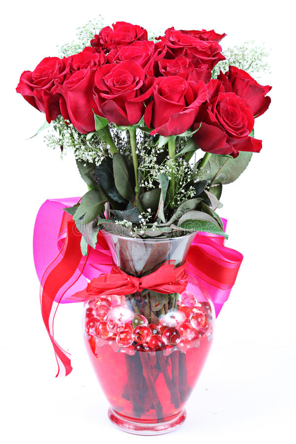 Dozen red roses in vase royalty free stock photography
