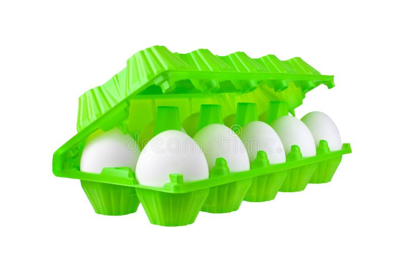 Dozen white eggs in bright green plastic package on white background isolated closeup side view royalty free stock photography