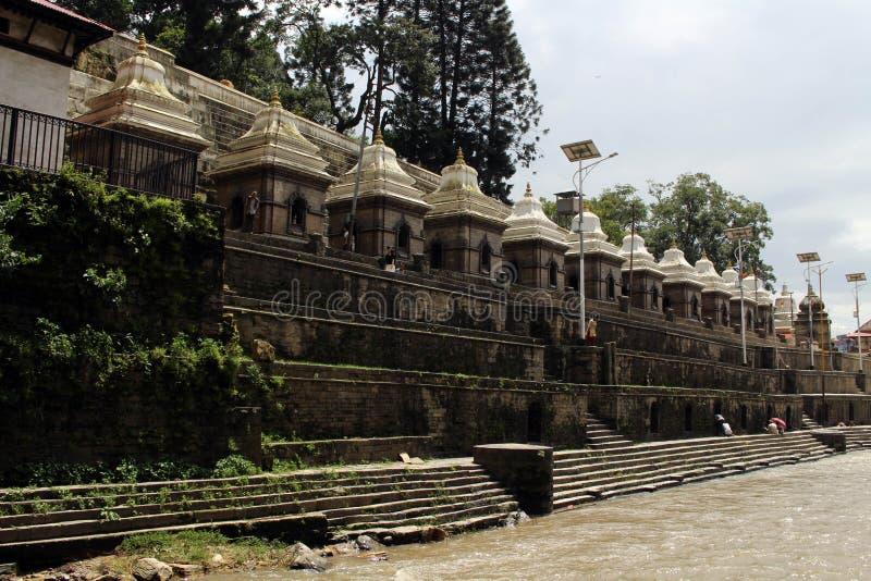 Dozens or hundreds of small temples across Bagmati River of Pashupatinath in Kathmandu stock image