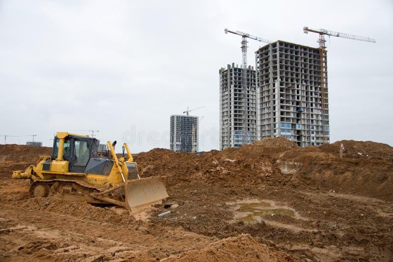 Dozer-Arbeiten an der Baustelle Bulldozer für die Räumung, Klassifizierung, Ausgrabung von Schwimmbecken, Sanierung und Fundament stockbild
