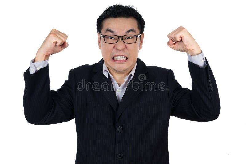 Dräkt och innehav för ilsken asiatisk kinesisk man båda bärande näve royaltyfri foto