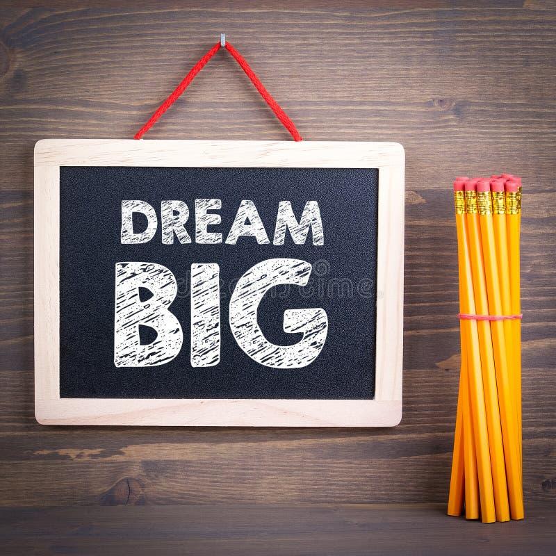 Dröm- stort Svart tavla på en träbakgrund arkivfoton