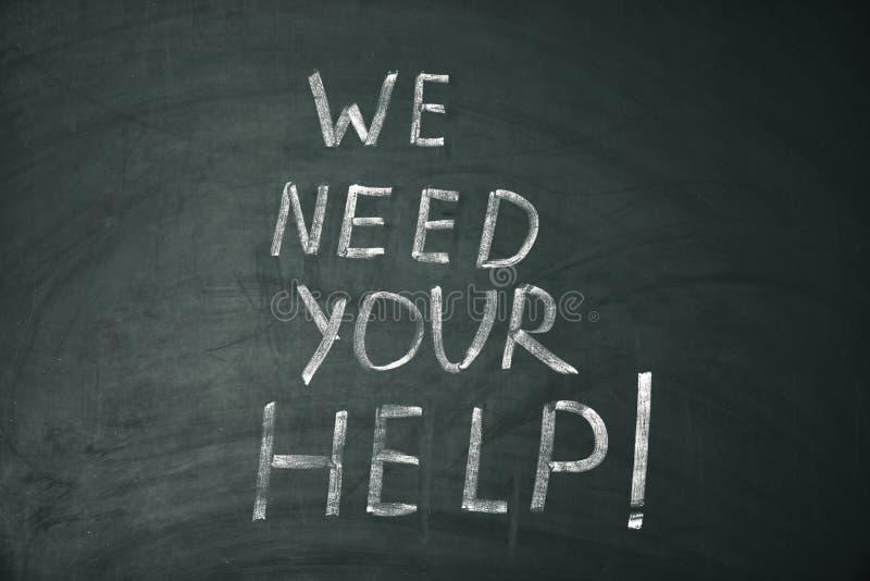 Drücken Sie 'uns benötigen Ihre geschriebene Hilfe 'aus lizenzfreies stockbild