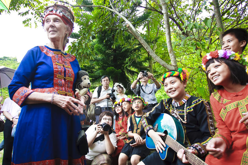 Dr. Jane Goodall aboriginal children in Taitung. Dr. Jane Goodall and Taitung aboriginal children. The children sing traditional songs to Dr. Goodall showing stock photography