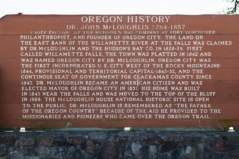 Dr. John McLoughlin Historical Sign. OREGON CITY, OREGON - April 11, 2014: A wooden sign with historical information on Dr. John McLoughlin at the Willamette royalty free stock photo