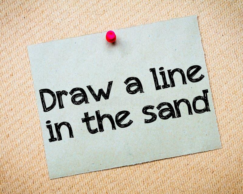Dra en linje i sanden royaltyfri foto