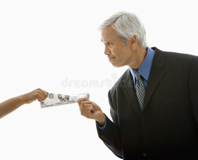 dra för pengarfolk arkivfoto