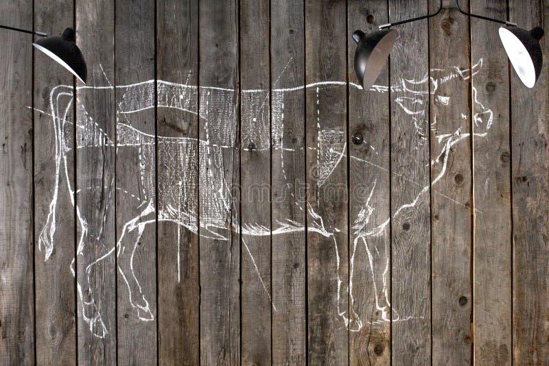Dra intriger av en ko arkivfoto