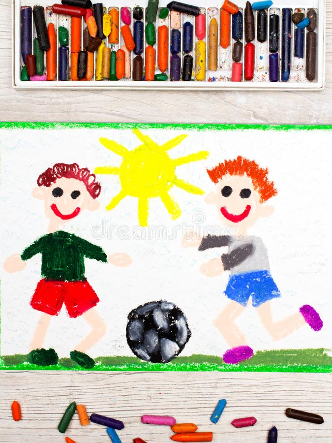 dra: Lekfotboll för två pyser modig fotboll royaltyfri fotografi