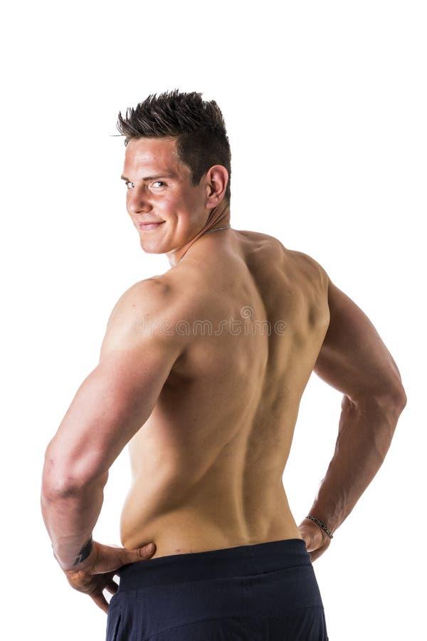 Dra tillbaka av det topless muskulösa mananseendet, studioskott arkivbilder
