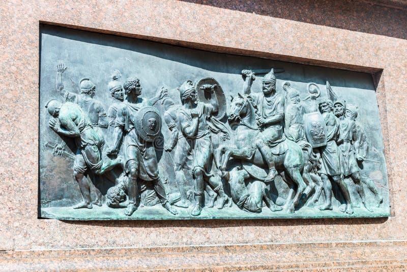 Dra tillbaka av lättnaden på monumentet till Minin och Pozharsky i Mos arkivbild