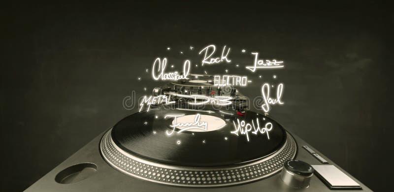 Draaischijf met vinyl en muziek geschreven genres stock foto