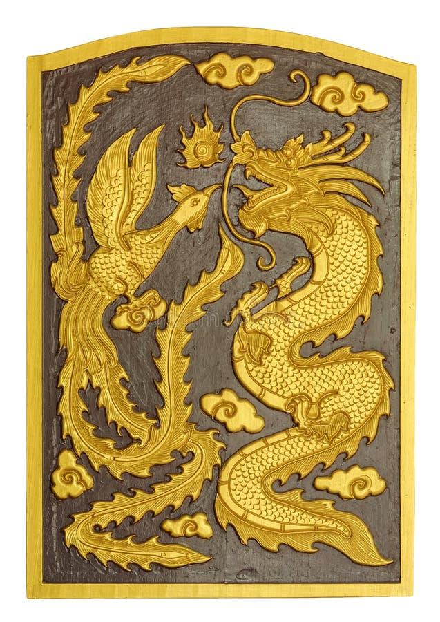 Draak en zwaan gesneden patroon op de houten textuur royalty-vrije stock afbeelding