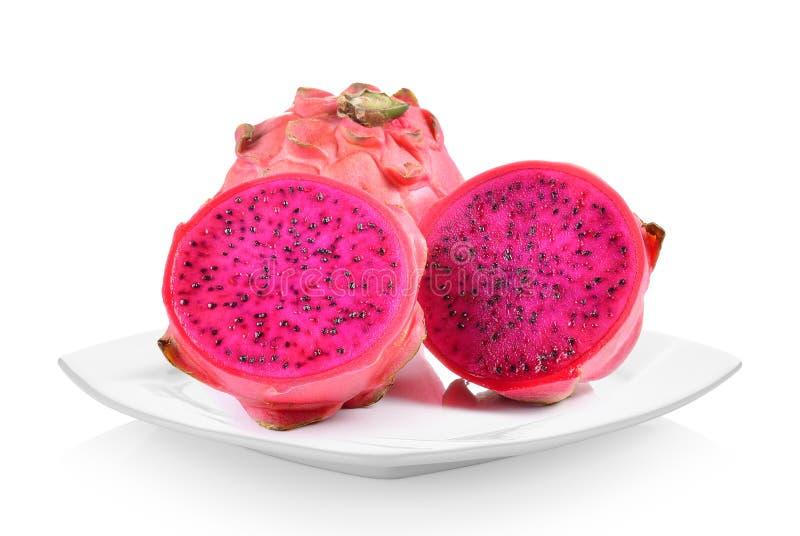 Drachefrucht in der weißen Platte auf weißem Hintergrund stockbilder