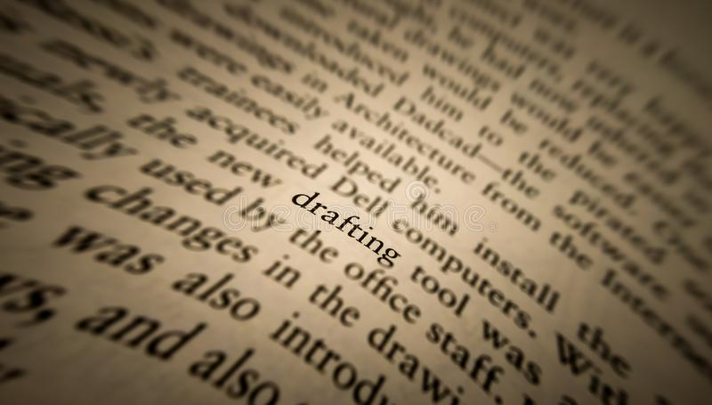 drafting word highlighted and focused in an old book stock photography