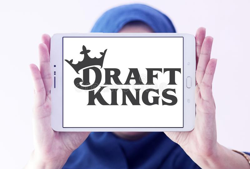 DraftKings fantasy sports company logo. Logo of DraftKings company on samsung tablet holded by arab muslim woman. DraftKings is a Boston, MA, daily fantasy royalty free stock photos